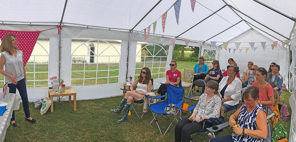 marquee full of enthusiastic business women